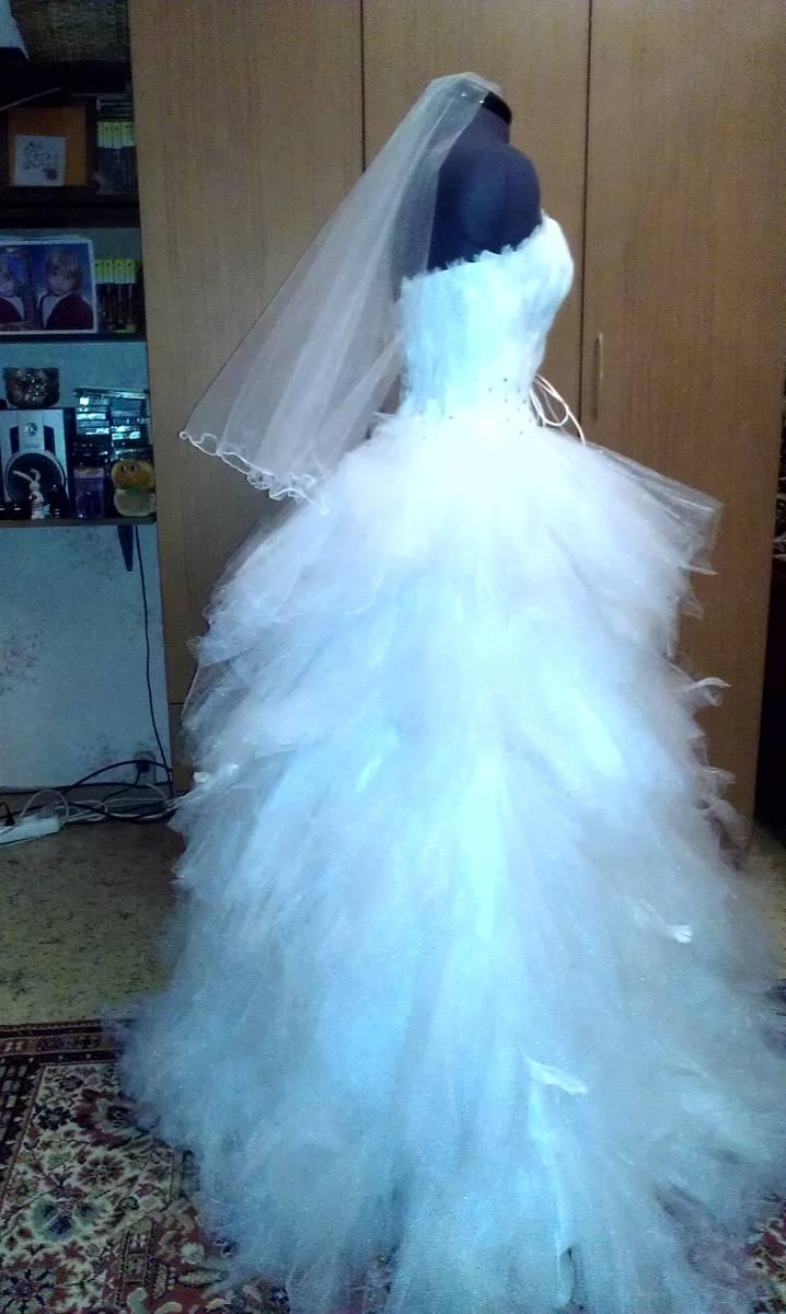 Свадебные платья белой лебеди